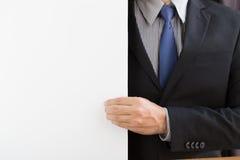 Mano del fondo di bianco di tirata dell'uomo d'affari Immagine Stock