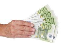 Mano del hombre con los billetes de banco euro Imagen de archivo