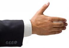 Mano del hombre de negocios extendido para un apretón de manos. Imagenes de archivo