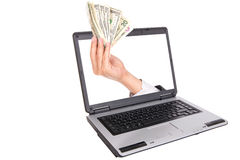 Mano del hombre de negocios que lleva a cabo muchas cuentas de dólar Fotos de archivo libres de regalías