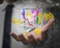 Mano del hombre de negocios que muestra las muestras de dólar transparentes de cristal del cubo Imagen de archivo libre de regalías