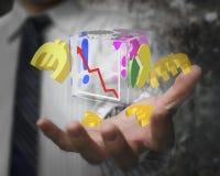 Mano del hombre de negocios que muestra los símbolos transparentes de cristal del euro del cubo Fotos de archivo libres de regalías