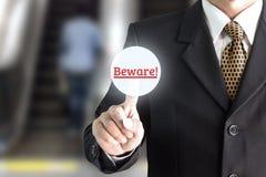 Mano del hombre de negocios que señala en el telclado numérico de la pantalla cuidadoso fotografía de archivo libre de regalías