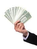 Mano del hombre de negocios que sostiene el dinero Fotos de archivo