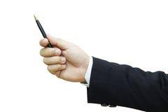 Mano del hombre de negocios que sostiene una pluma Imagenes de archivo
