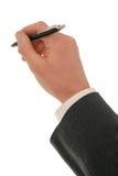Mano del hombre de negocios que sostiene una pluma Imágenes de archivo libres de regalías