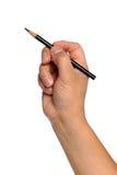 Mano del hombre que sostiene el lápiz negro Imagen de archivo libre de regalías