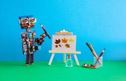 Mano del lápiz del artista del robot que estudia las hojas de otoño de madera de las ilustraciones de la aún-vida del caballete E Imagen de archivo