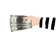 Mano del ladrón que sostiene el dinero de 100 billetes de banco del dólar Fotos de archivo