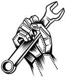 Mano del metal con la llave inglesa stock de ilustración