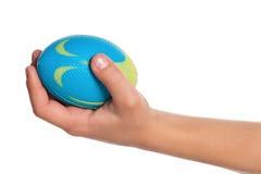 Mano del muchacho con la pequeña bola Imagen de archivo libre de regalías