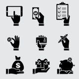 Mano del negocio con los iconos del objeto fijados Foto de archivo libre de regalías