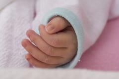 Mano del neonato Immagini Stock