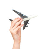 Mano del niño que sostiene el aeroplano modelo fotografía de archivo
