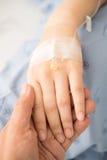 Mano del paciente del control de la mano Imagen de archivo