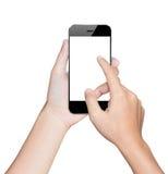 Mano del primer usando la trayectoria de recortes móvil blanca del smartphone fotografía de archivo