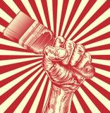 Mano del puño del grabar en madera de la brocha de la propaganda ilustración del vector