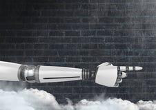 Mano del robot de Android que señala con el fondo de la oscuridad de la pared de ladrillo Foto de archivo