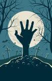 Mano del zombi que explota de debajo la tierra Imágenes de archivo libres de regalías
