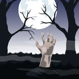 Mano del zombi que se pega fuera de la tierra en la Luna Llena Fotografía de archivo libre de regalías