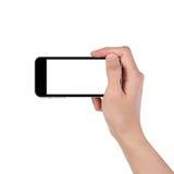 Mano dell'uomo che tiene lo smartphone nero Fotografie Stock