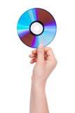 Mano dell'uomo che tiene un compact disc fotografie stock