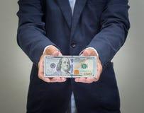 Mano dell'uomo d'affari che afferra USD Fotografia Stock Libera da Diritti