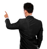 Mano dell'uomo d'affari che spinge schermo virtuale Immagini Stock