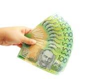 Mano della donna che tiene i dollari australiani Fotografia Stock
