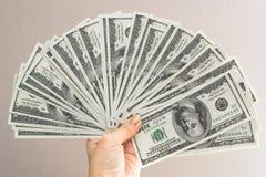 Mano della donna con i dollari isolati su un fondo bianco Immagine Stock Libera da Diritti