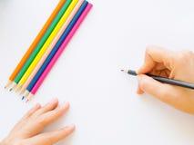 Mano della donna con scrittura della matita Fotografia Stock
