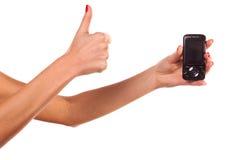 Mano della donna e telefono mobile. Immagine Stock