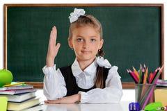 Mano della scolara in su Immagine Stock