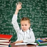 Mano della scolara in su Fotografia Stock