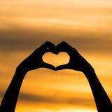 Mano della siluetta nella forma del cuore Immagine Stock Libera da Diritti
