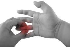 Mano della tenuta al punto di dolore del dito Immagine Stock