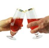 Mano delle femmine che tiene i vetri di vino rosso Fotografia Stock