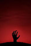Mano dello zombie che viene su Fotografie Stock