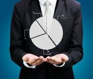 Mano derecha de la postura del hombre de negocios que lleva a cabo finanzas del gráfico aisladas Imágenes de archivo libres de regalías