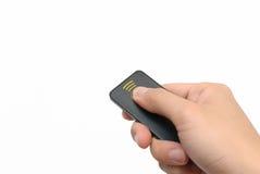 Mano derecha usando el telecontrol Fotografía de archivo