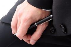 Mano di affari con la penna fotografia stock