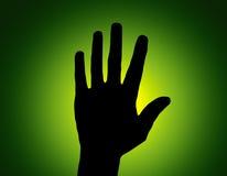 Mano di arresto della siluetta su verde Immagine Stock