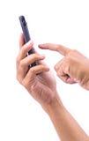 Mano di tocco sullo Smart Phone isolato su bianco Fotografia Stock Libera da Diritti