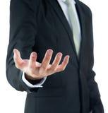 Mano diritta di manifestazione di posizione dell'uomo d'affari isolata Immagini Stock