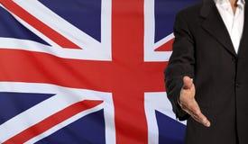 Mano e bandiera aperte della Gran Bretagna nei precedenti Immagine Stock Libera da Diritti