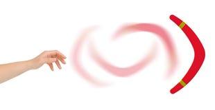 Mano e boomerang Fotografie Stock Libere da Diritti