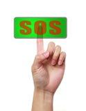 Mano e bottone SOS Immagini Stock