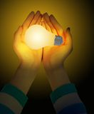 Mano e lampadine Fotografia Stock