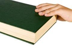 Mano e libro Fotografia Stock
