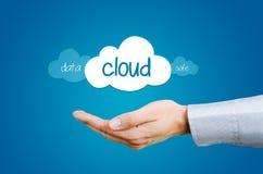 Mano e nuvole con la composizione in parole della cassaforte ed in dati Fotografie Stock Libere da Diritti